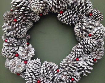 Eleagant white pine cone wreath.