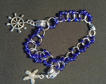 Silver Chain Mail Bracelet with Blue Beads and Two Silver Charms