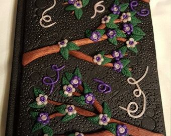 J2 -Black polymer clay with purple and pink and bronze accents