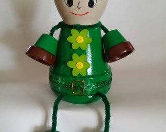 Clay pot person with green