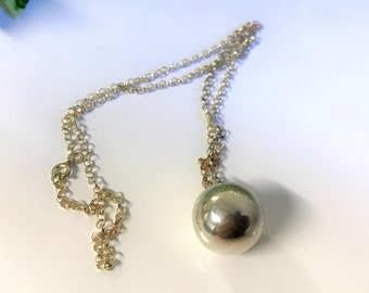 A Charmimg Vintage Sterling Silver 15mm Harmony Ball Holiday Jingle Pendant Necklace and Sterling Silver Chain