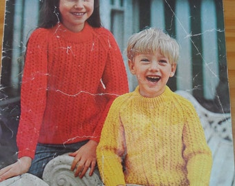 Vintage knitting pattern by Patons for child's double knit sweater in chest sizes 22-33""