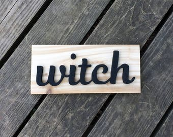 WITCH sign made from cedar treehouse scraps
