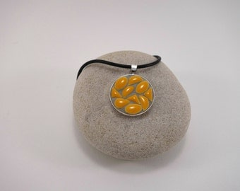 Necklace with a Medallion enamelled yellow ceramic micro-mosaique and neck black rubber