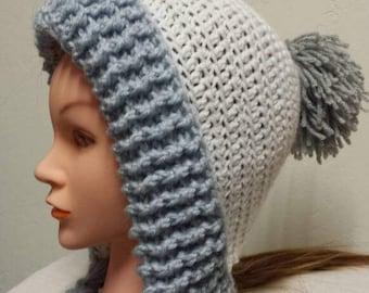 Crochet earflap hat with pom pom and braids.