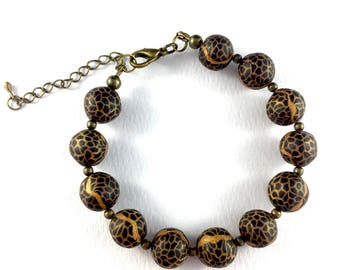Handcrafted polymer clay bracelet- black and gold snakeskin effect