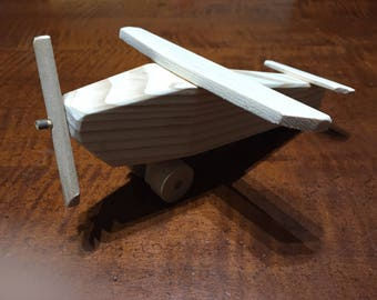 Toy plane made of spruce wood