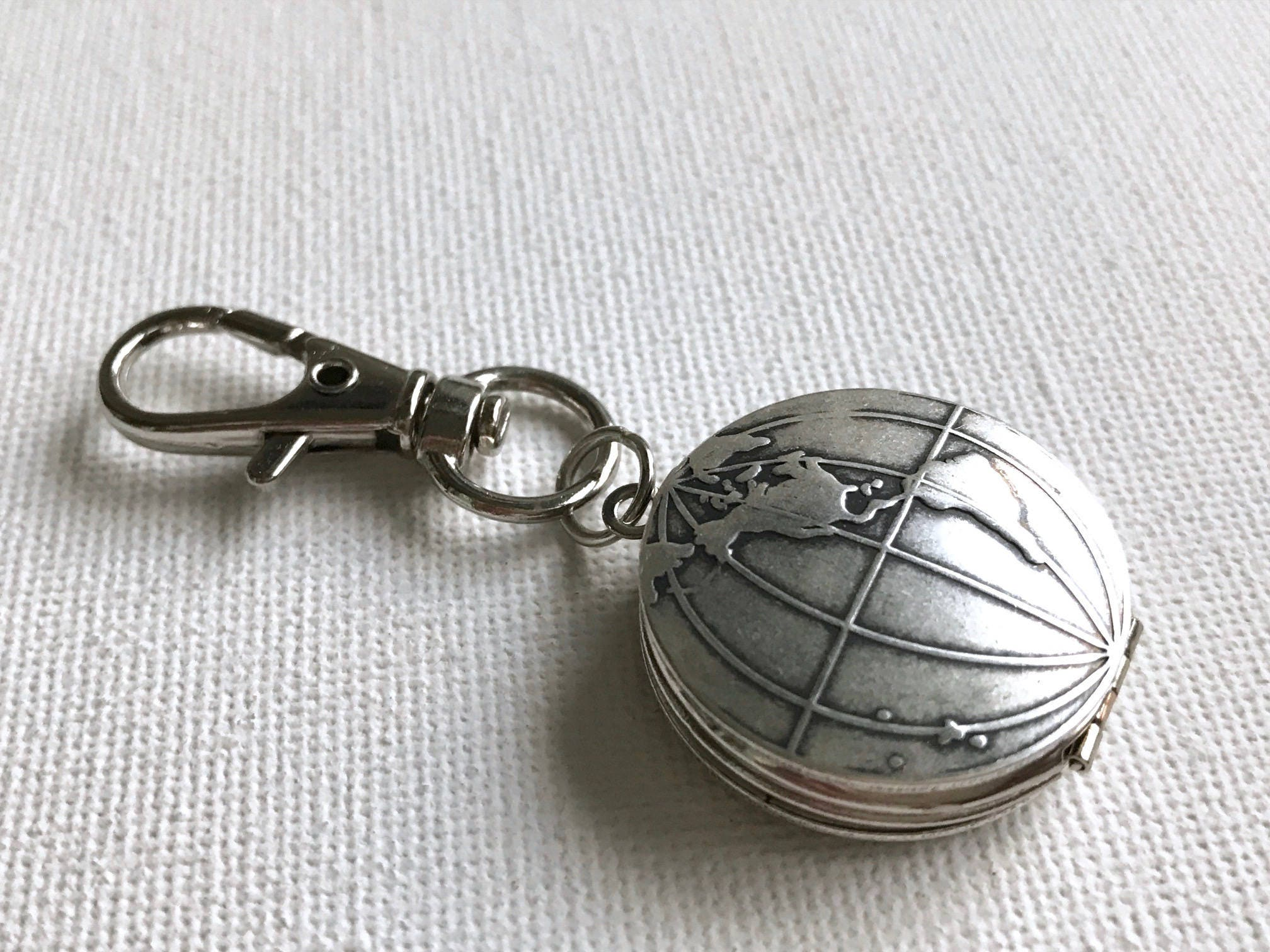 Silver world keychain world map locket globe locket traveler gift silver world keychain world map locket globe locket traveler gift world traveler gumiabroncs Image collections