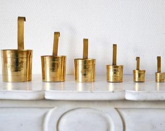 Beautiful suite of 6  brass cuisine measuring cups