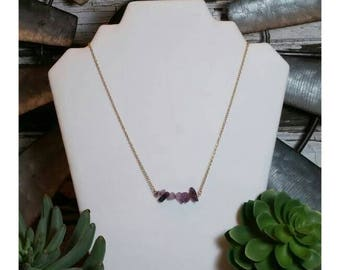 Purple stone necklace on silver chain