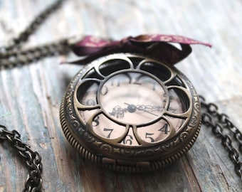 Alice in Wonderland themed necklace, bronze colored costume jewelry, watch and toadstool, whimsical necklaces