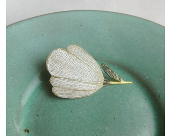 White flower brass brooch