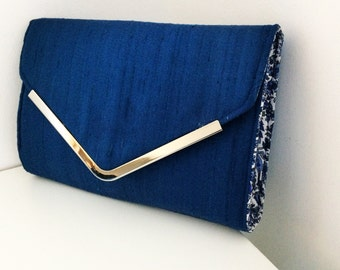 Royal blue satin clutch bag