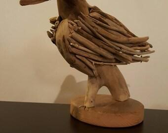 Oiseau en bois flotté