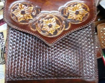 Hand carved leather bag