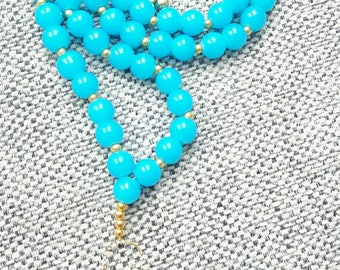 Beautiful bright turquoise coloured Pearl Necklace with Guardian Angel