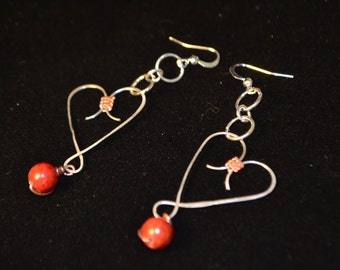 Handcrafted silver and copper hearts with sponge coral