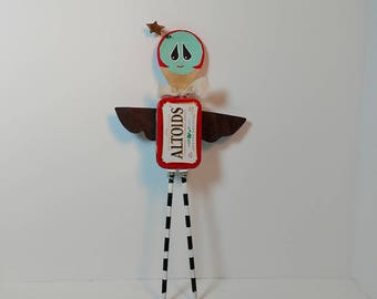 Whimsical ANGEL wall decor, girl assemblage, metal sculpture, altered Altoid tin, wall hanging, wooden spoon, abstract, red, black stripe