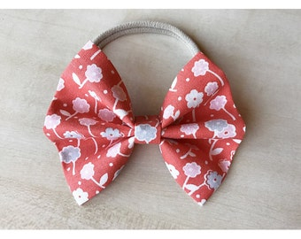 Orange poppy floral bow