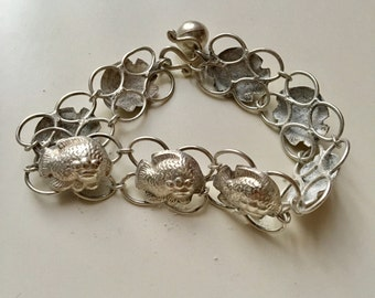 Vintage 925 silver fish shaped with jingle bracelet.