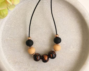Rose gold necklace , clay necklace , black and rose gold necklace , beaded necklace