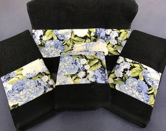Set of four beautiful blue flower embellished hand towels available in black or white