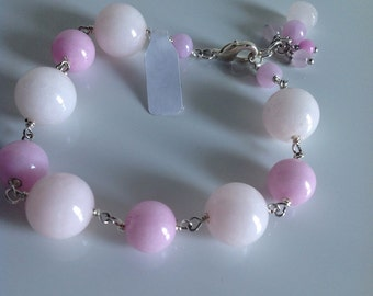 Jade bracelet in shades of pink with round stones and small pink jade stones always enriched final