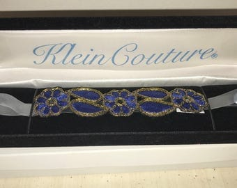 Striking blue and gold floral garter set on a silicone strap