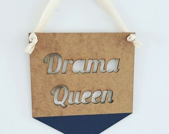 Natural wooden flag with the words  Drama Queen