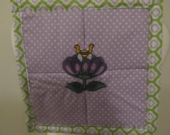 Its time to stop and smell the flowers potholder