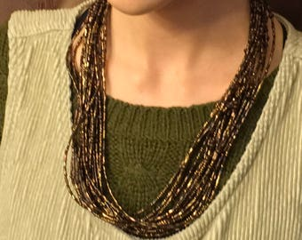 Multi strand brown beaded necklace.