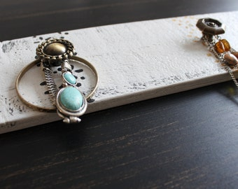 Support necklaces and bracelets. Wall hanging jewelry display. Decorative storage. 4.5 x 16 inches.
