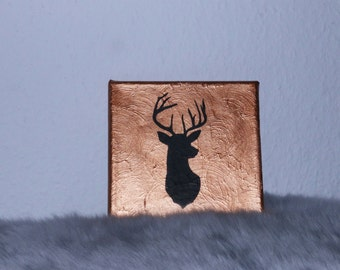 Deer head silhouette on canvas