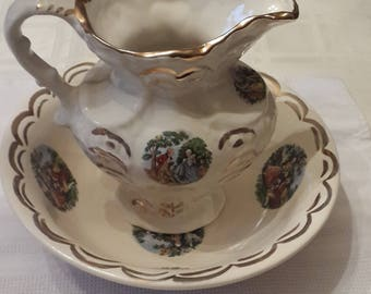 Antique wash basin bowl and pitcher set with colonial couple and gold guilt