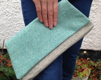 Turquoise and grey clutch bag