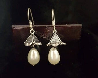 Pagoda influenced faux pearl earrings