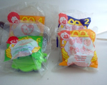 4 McDonald's Happy Meal Toys 1996 & 1997 New in package
