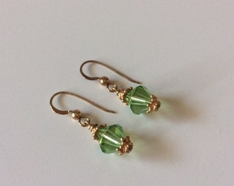 Dainty earrings with peridot Swarovski crystals and gold vermeil accents.