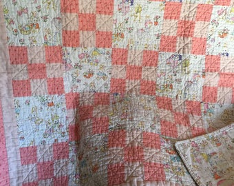Vintage looking baby girl, machine pieced and quilted quilt. 38x39