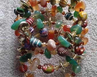 Green and orange bohemian wrap bracelet