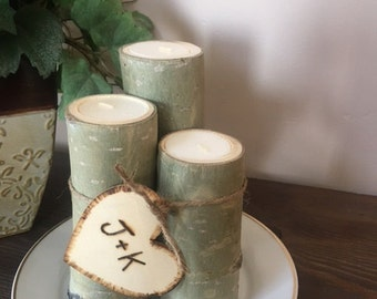 3 aspen logs with tea light candles