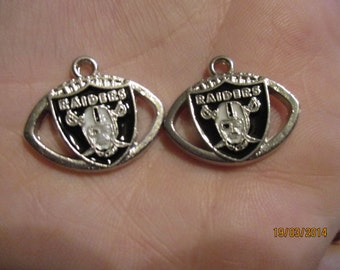 Set of 2 Raiders football charms.