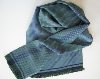 Hand-woven soft scarf in blue green tones