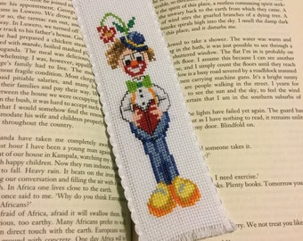 Bookmark - Clown reading a book