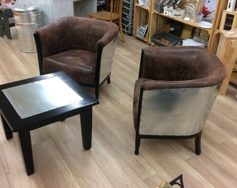 Revisited barrel zinc and aged leather armchairs