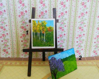 The pictures painted.Dolls house miniature. Handcrafted miniature.  1:12 Scale