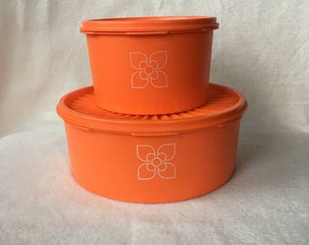 Set of two orange tupperware cake drums/containers with lids