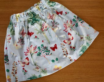 girls skirt, blue floral with butterflies. One only size 5 - 6