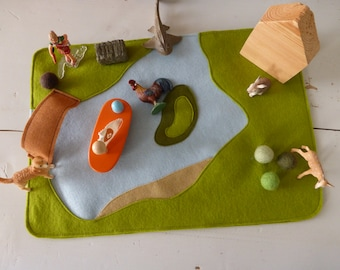 Wool felt playmat lake with one wooden house