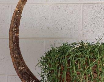 Vintage full circle plant hanging basket.
